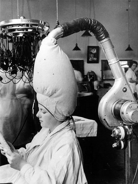 Fortunately, we don't have to dry our hair like this anymore. Photo courtesy of Life.